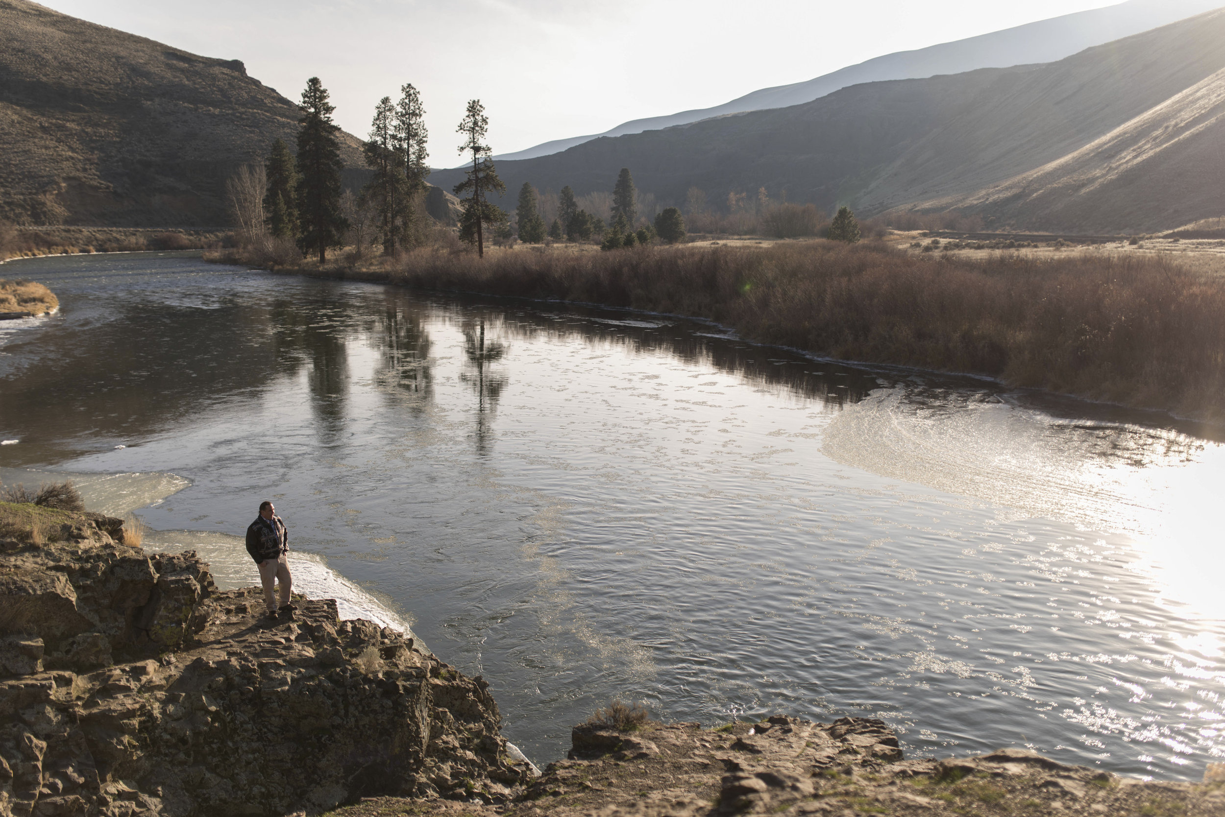 Phil Rigdon, of the Yakama Nation, stands near the Yakima River. Photo by Steven Gnam