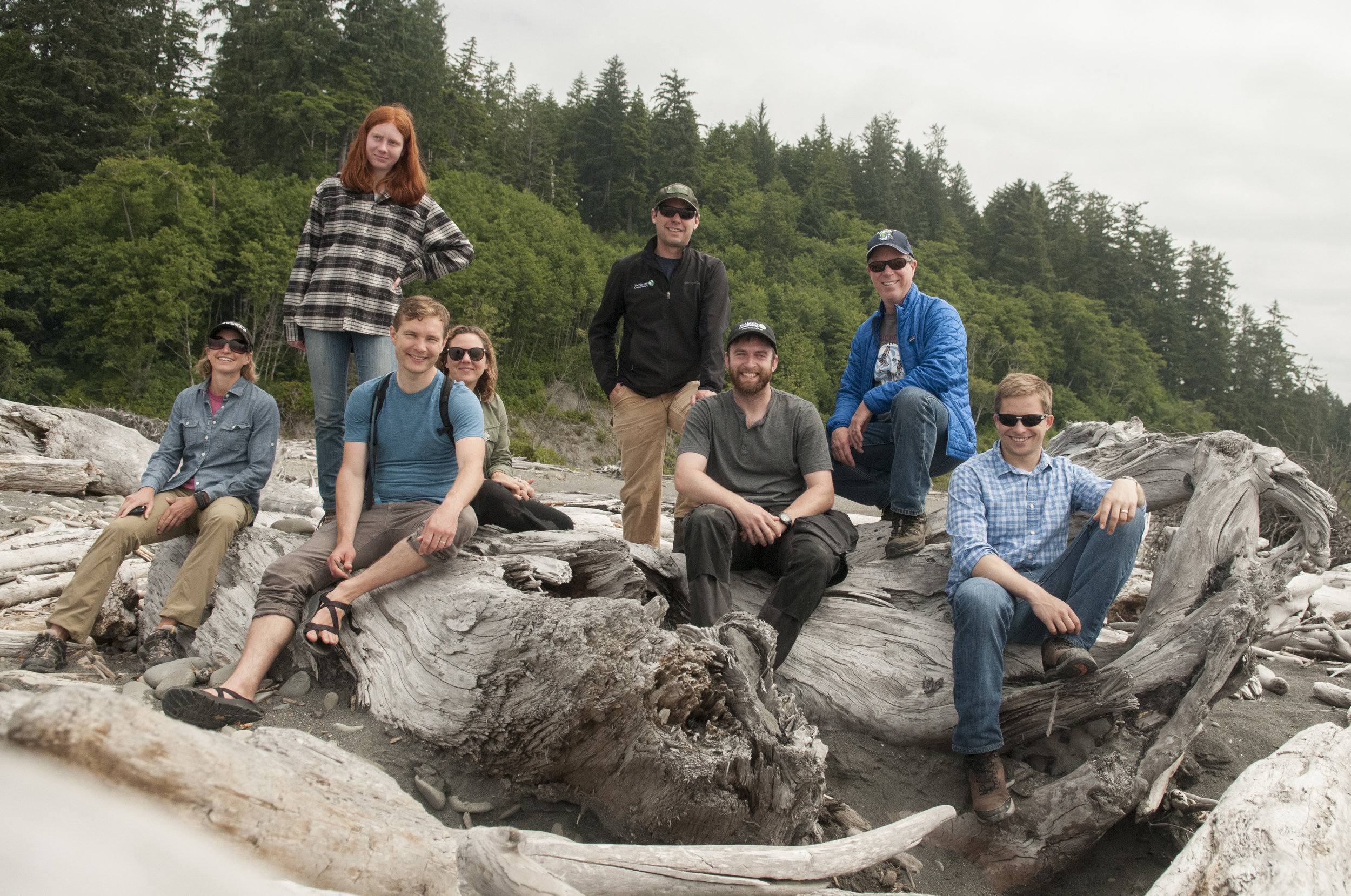 Nature Conservancy in Washington staff exploring near the mouth of the Hoh River. Photo by Nikolaj Lasbo/TNC