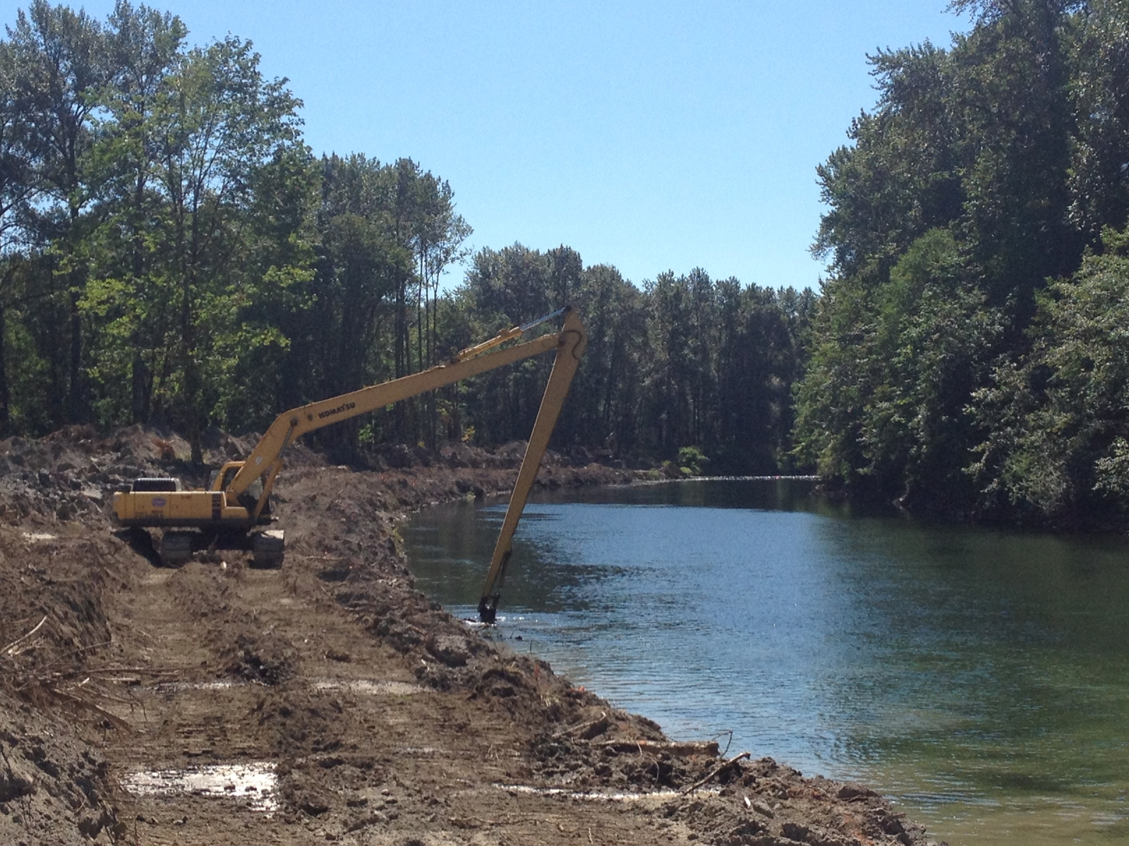 A long-arm excavator was used to remove as much levee toe rock as possible, part of a Floodplains by Design project. Photo by King County.
