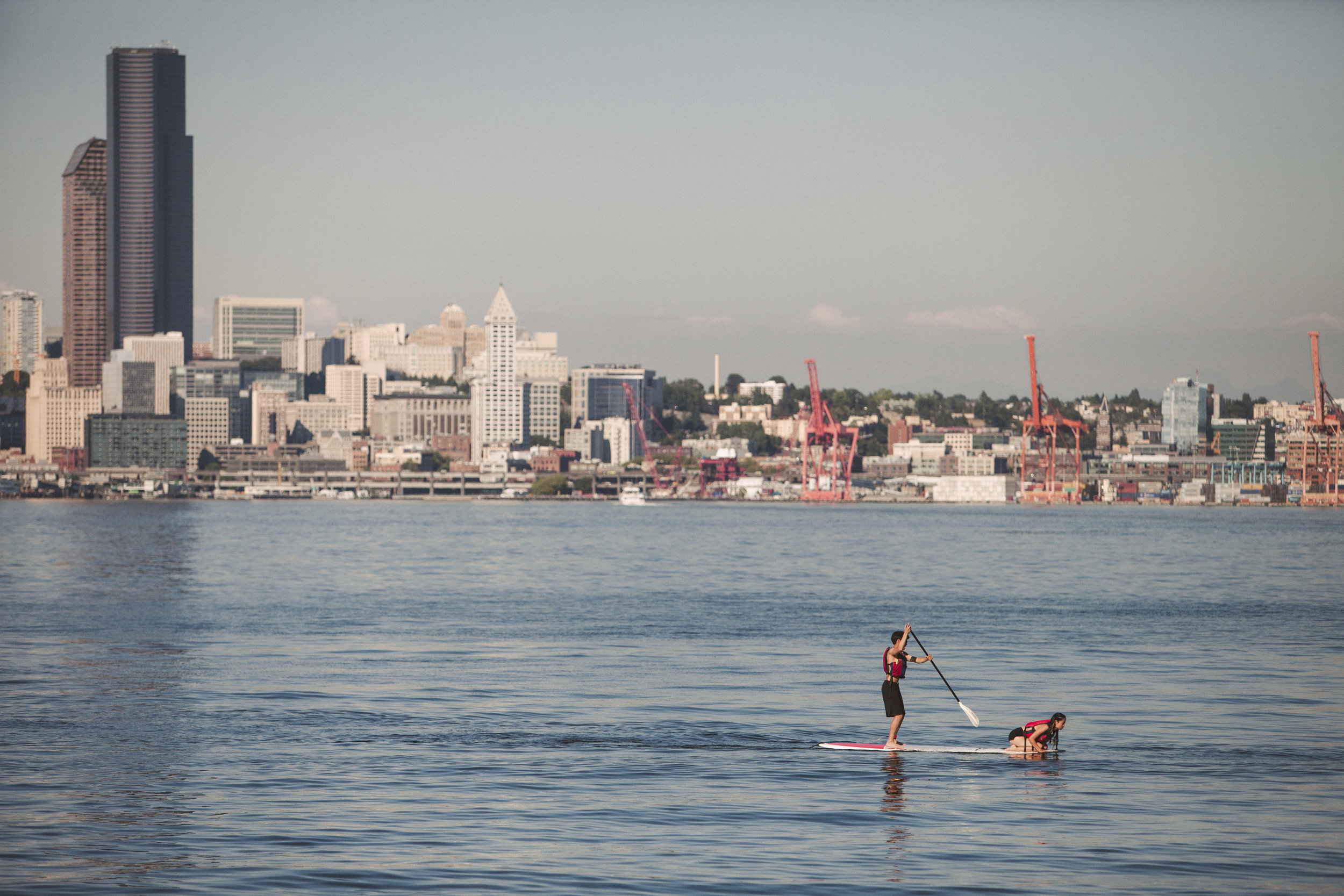 Seattle skyline from West Seattle, where Alki Beach offers recreation for all. Photo by Jeff Marsh.