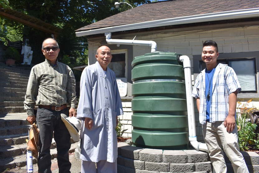 Pictured above (left to right): Tom Le (Sky Landscaping Services), Master An (Head Monk at Chua Co Lam), and Kevin Duong (Vietnamese Community Coordinator at ECOSS) in front of the temple office.