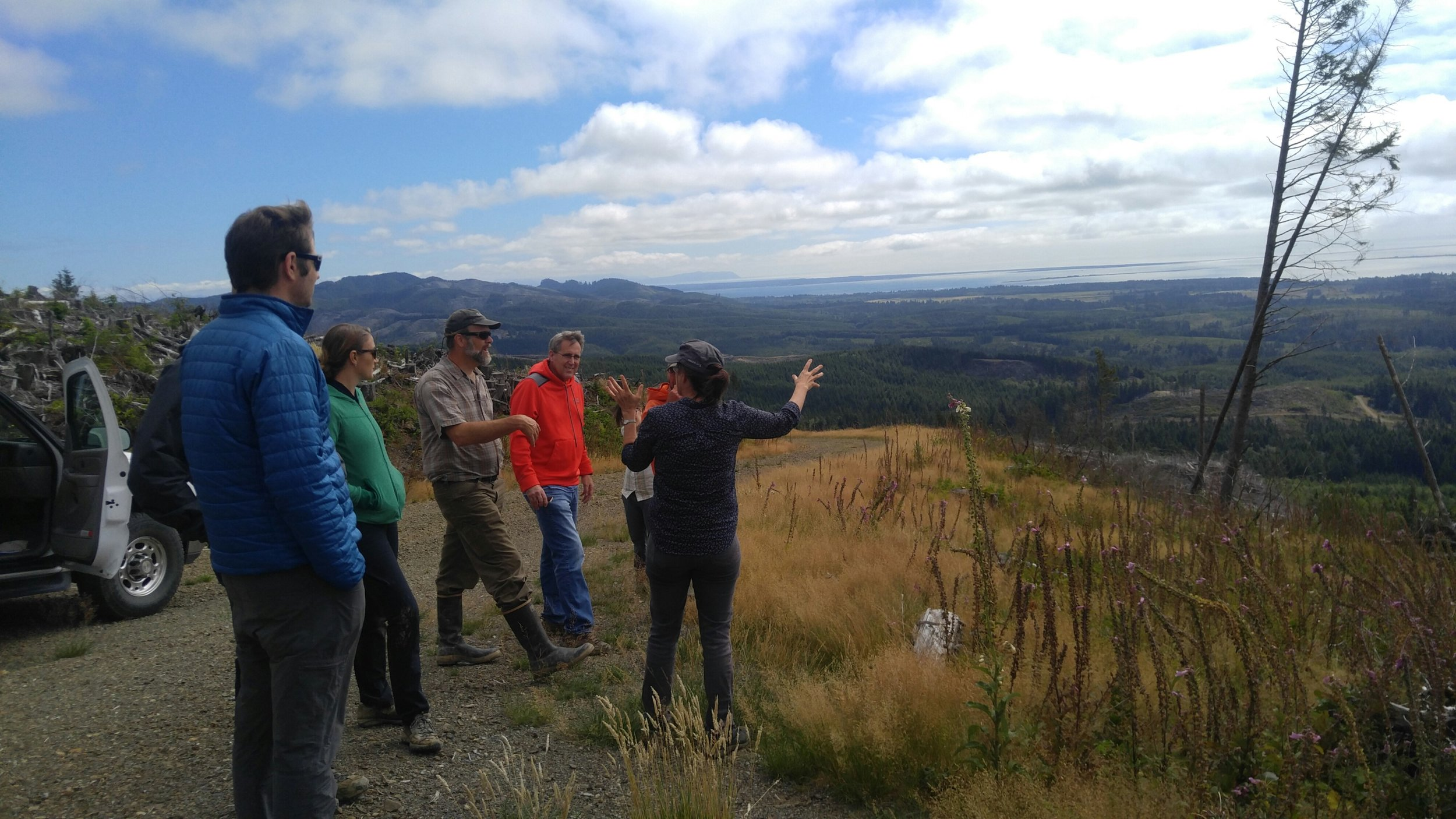 TNC's Federal Government Relations Director Cathy Baker and Tom Kollasch from Pacific County Conservation District talk with the group while overlooking the cooperatively managed lands and the Columbia River delta. Photo © Jessica Helsley