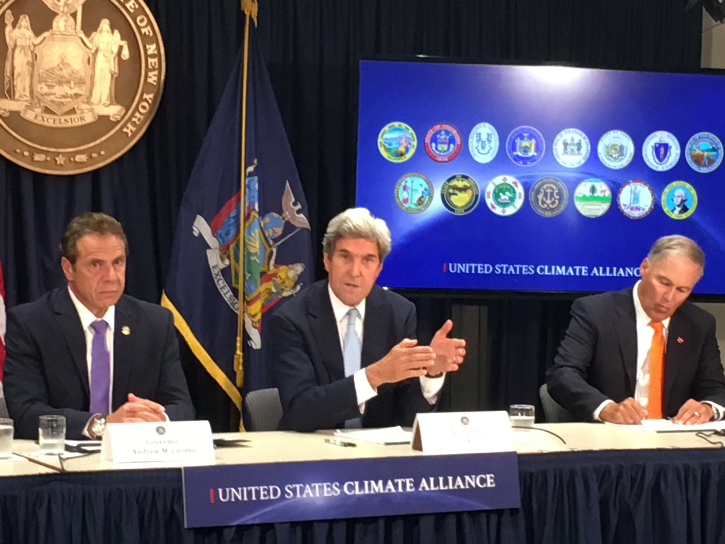 Governors Andrew Cuomo (NY) and Jay Inslee (WA) join former US Secretary of State John Kerry to announce progress of the US Climate Alliance.  Photo by TNC.