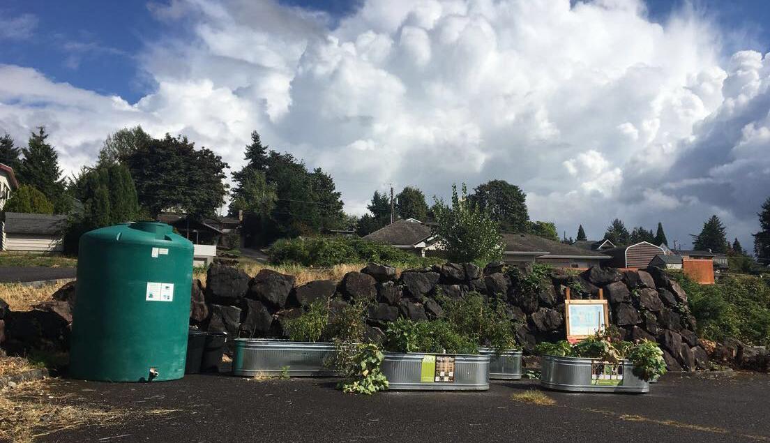 Planters and a cistern ready to be installed at  Hillside Paradise Parking Plots Community Garden . Photo © Hannah Kett/TNC