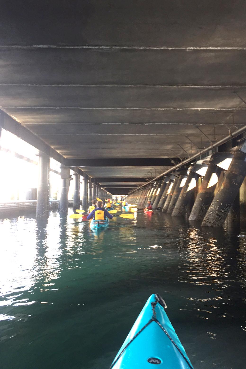 Kayaking beneath the Seattle Waterfront. Photo © Eric Delvin / TNC