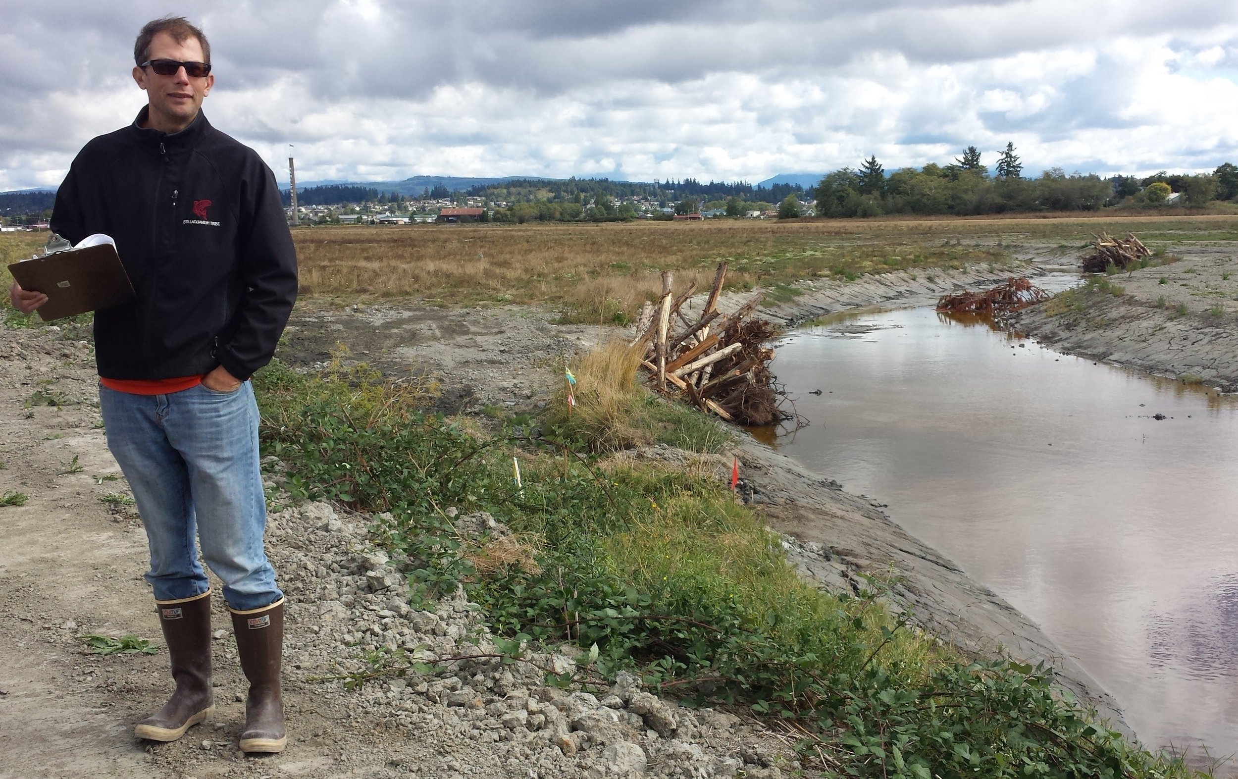 Project manager Jason Griffith with tidal channels constructed at Zis-a-ba. Photo ©Jenny Baker/TNC