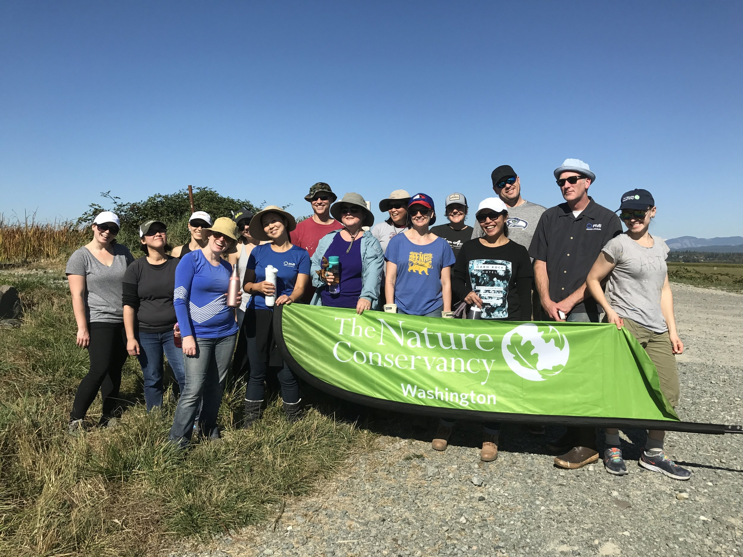PMI and Nature Conservancy staff at Port Susan Bay. Photo © Randi Shaw / TNC