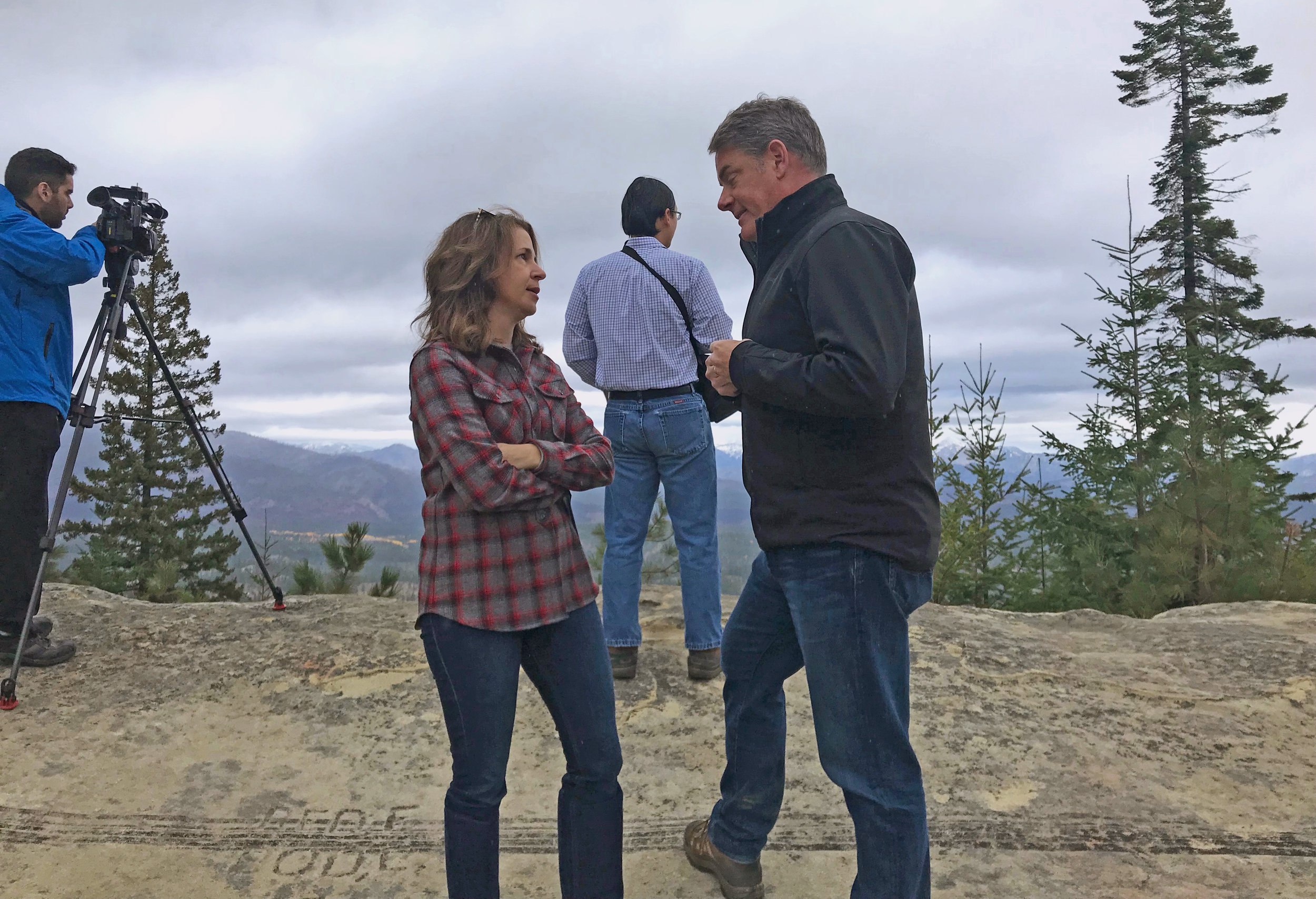 State Public Lands Commissioner Hilary Franz chats with James Schroeder, Director of Forest Conservation Partnerships for the Conservancy's Washington program, on Cle Elum Ridge overlooking the Teanaway Community Forest and the site of the Jolly Mountain Fire. Photo © Scott Richards/TNC