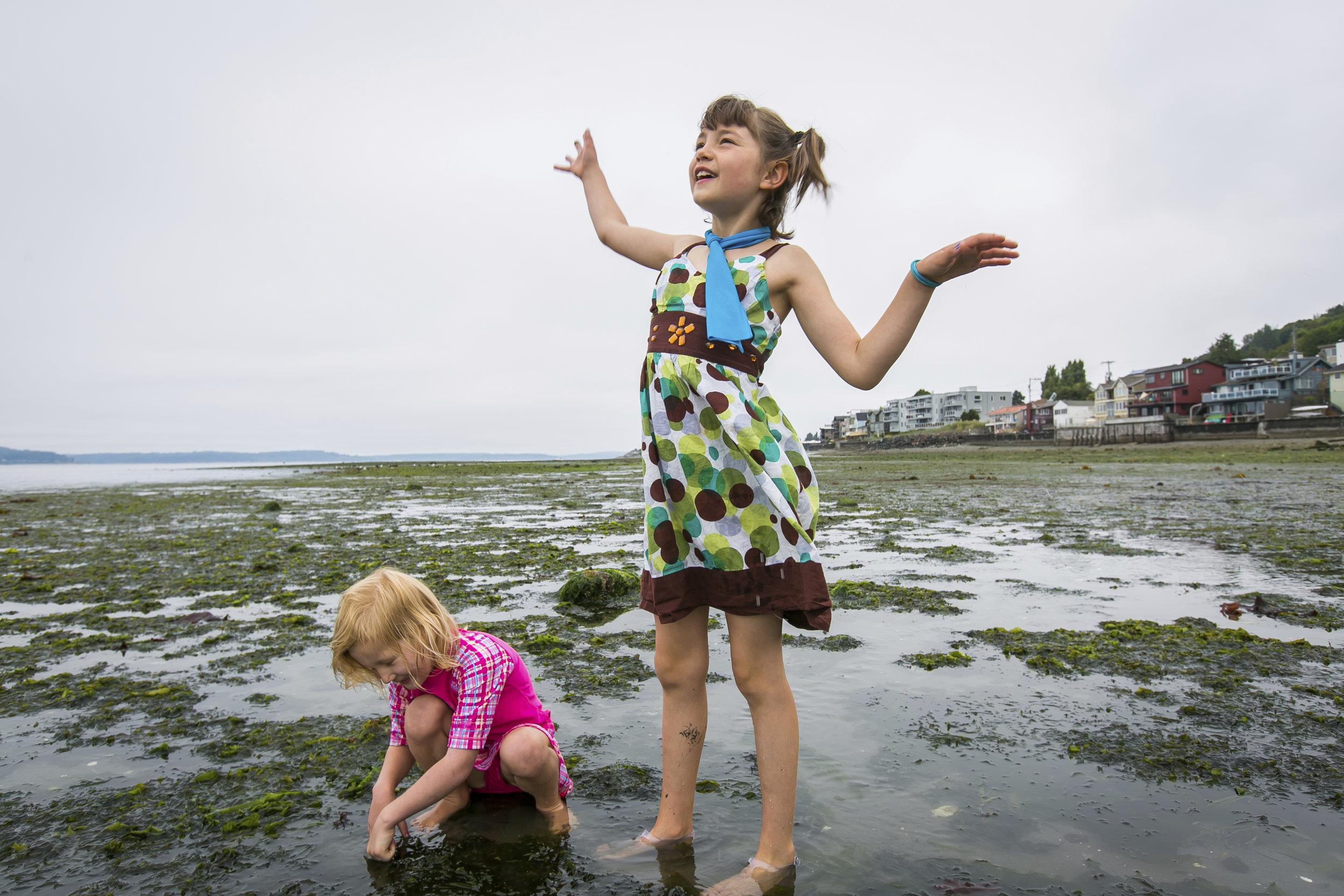 Children enjoy low tide on Alki Beach in West Seattle. Photo  © Paul Joseph Brown.