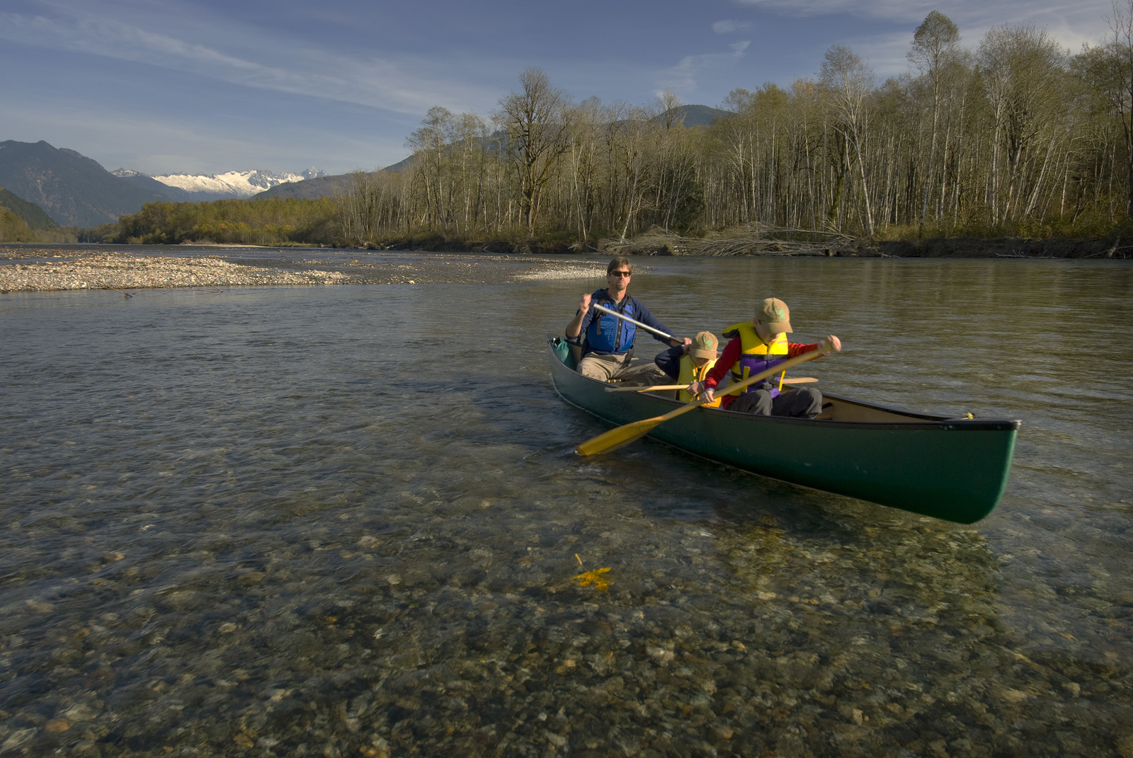 Bob Carey canoeing the upper Skagit River of Washington with his two sons. The Nature Conservancy has been working to preserve the mighty Skagit River for more than 30 years. Photo © Bridget Besaw.