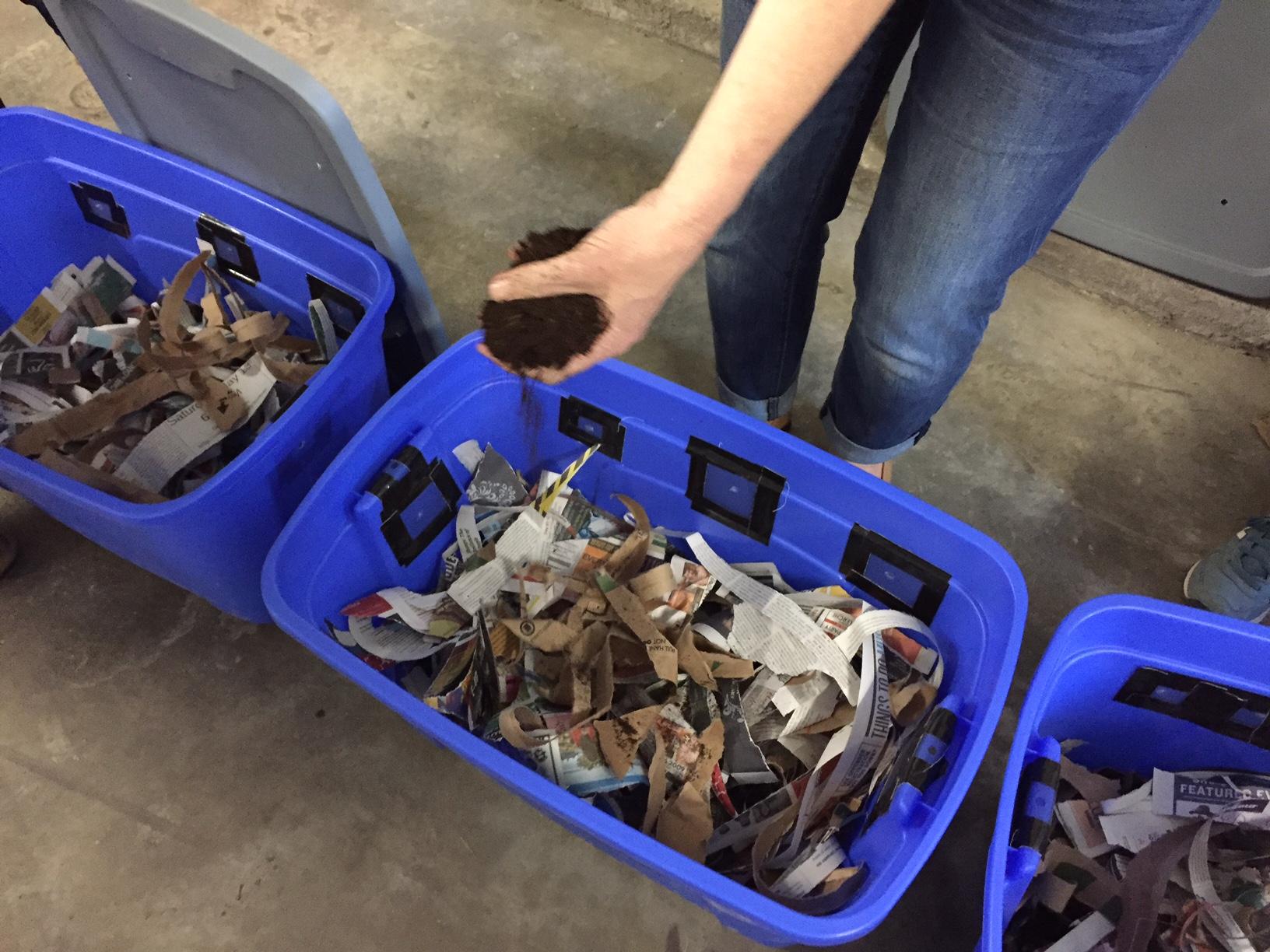 Building worm bins to use in Pathfinder's school garden. Photo courtesy of Tasha Mosher.