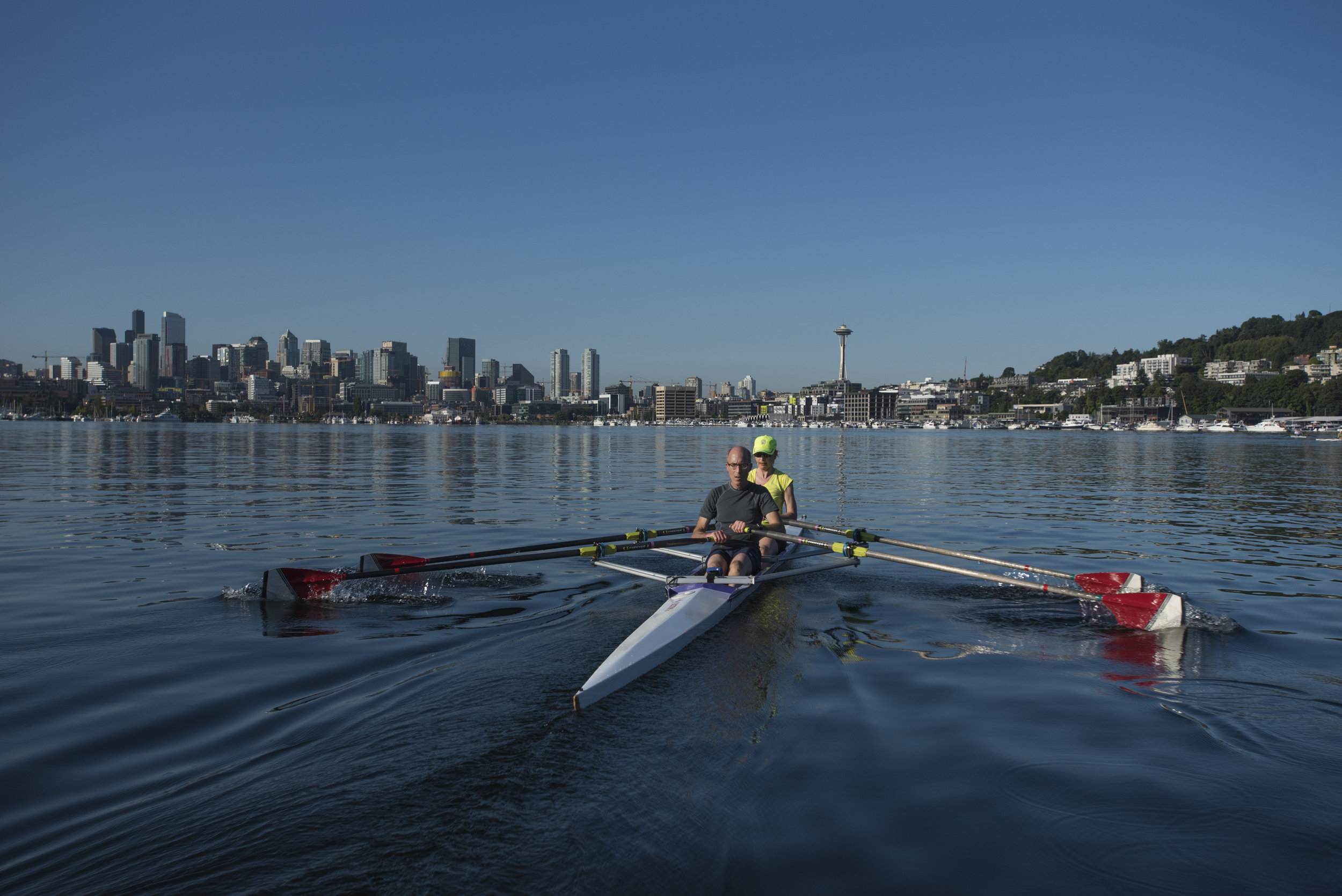 Louise Britton and David Goll  rowing on Seattle's Lake Union. Photo by Hannah Letinich.