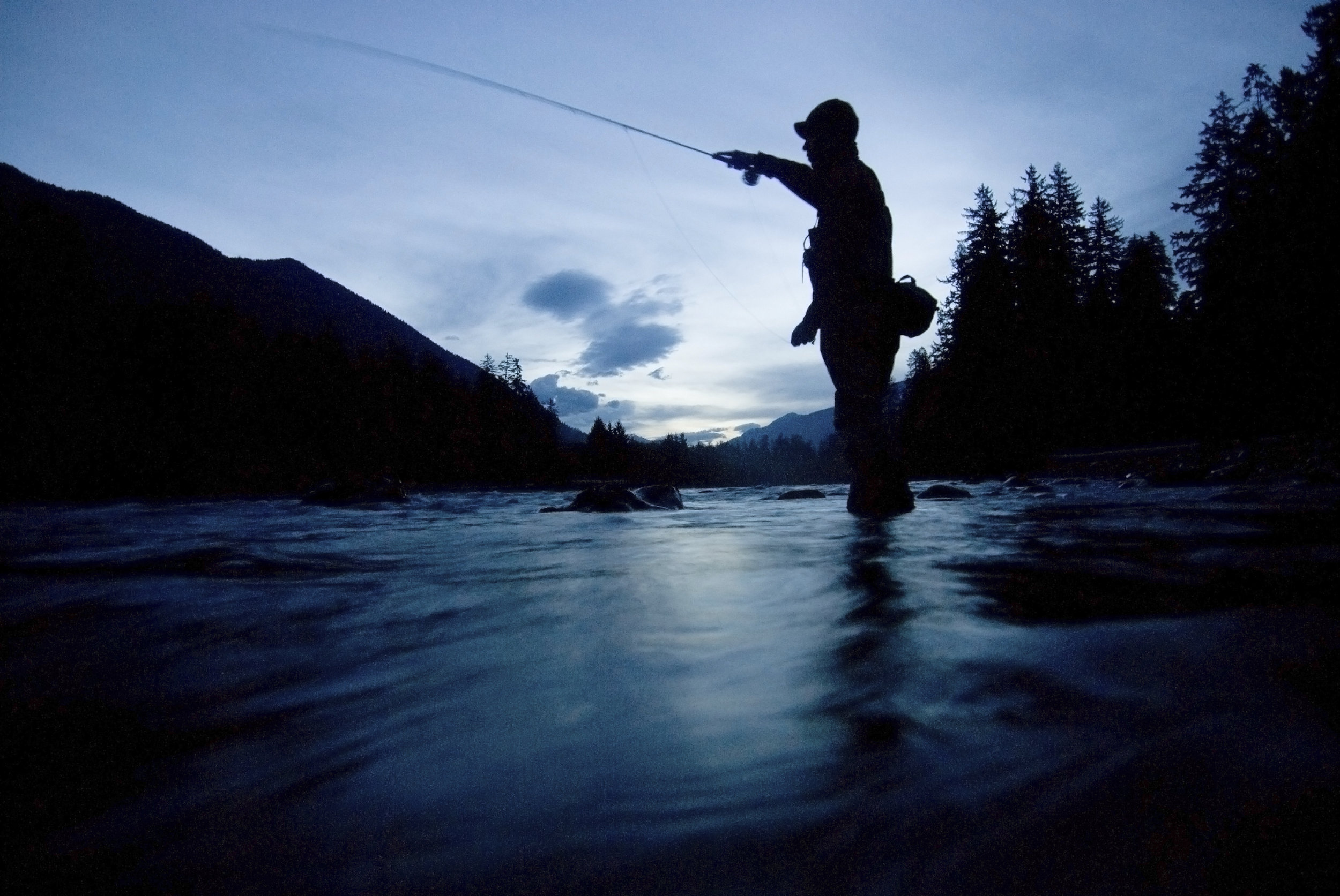 Fishing guide Shannon Carroll flyfishing at dawn for steelhead on the Hoh River in the Olympic Peninsula. Photo by Bridget Besaw.