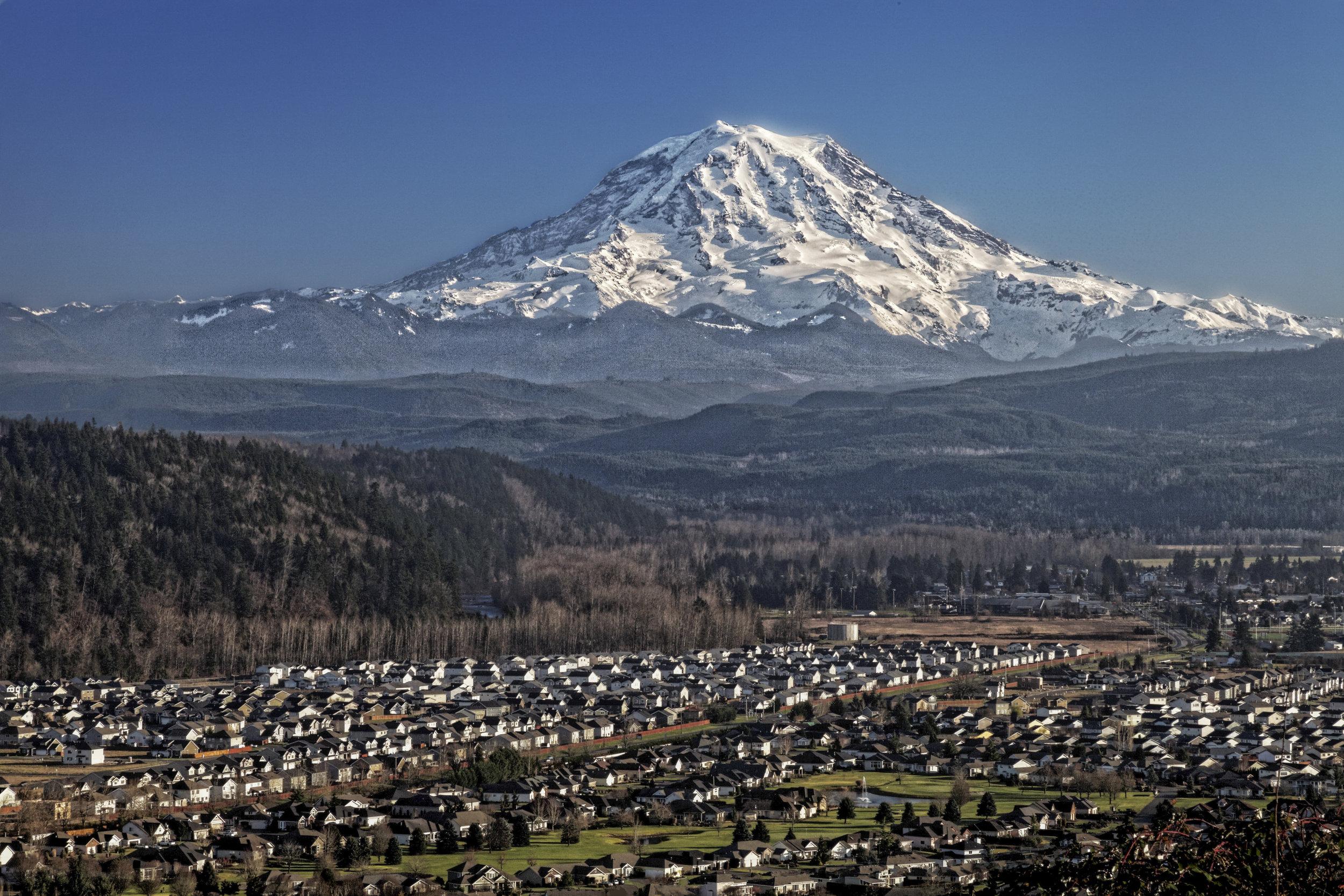 Mount Rainier Looms over the Puyallup Valley, Washington. © USGS