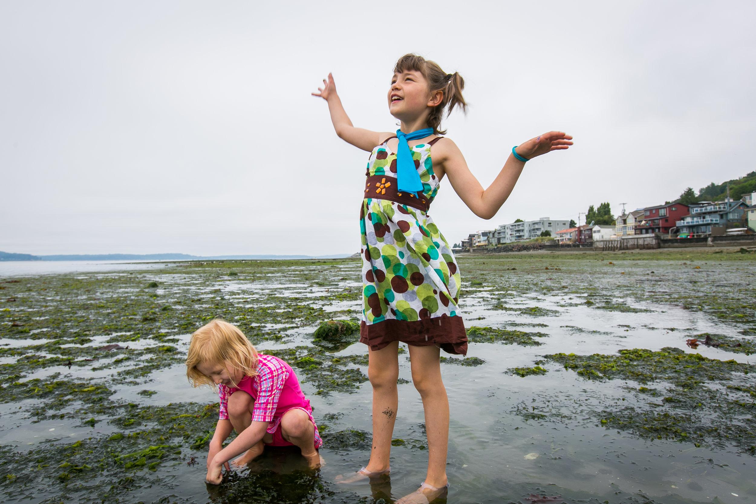 Children enjoy low tide on Alki Beach in West Seattle. Photo by Paul Joseph Brown.