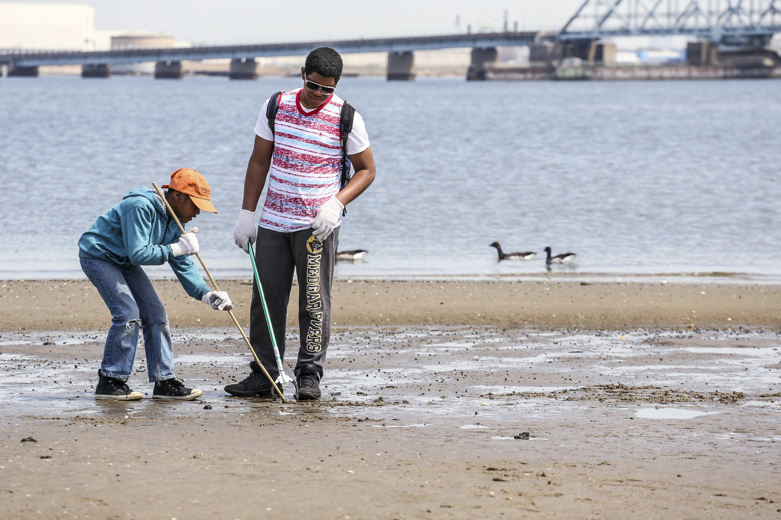 """More than 200 volunteers turned out to a """"Connect with Nature"""" beach cleanup at Jamaica Bay Wildlife Refuge in New York City.  Give an """"Hour for the Ocean"""" at a beach cleanup near you this Saturday!  Photo by Jonathan Grassi."""