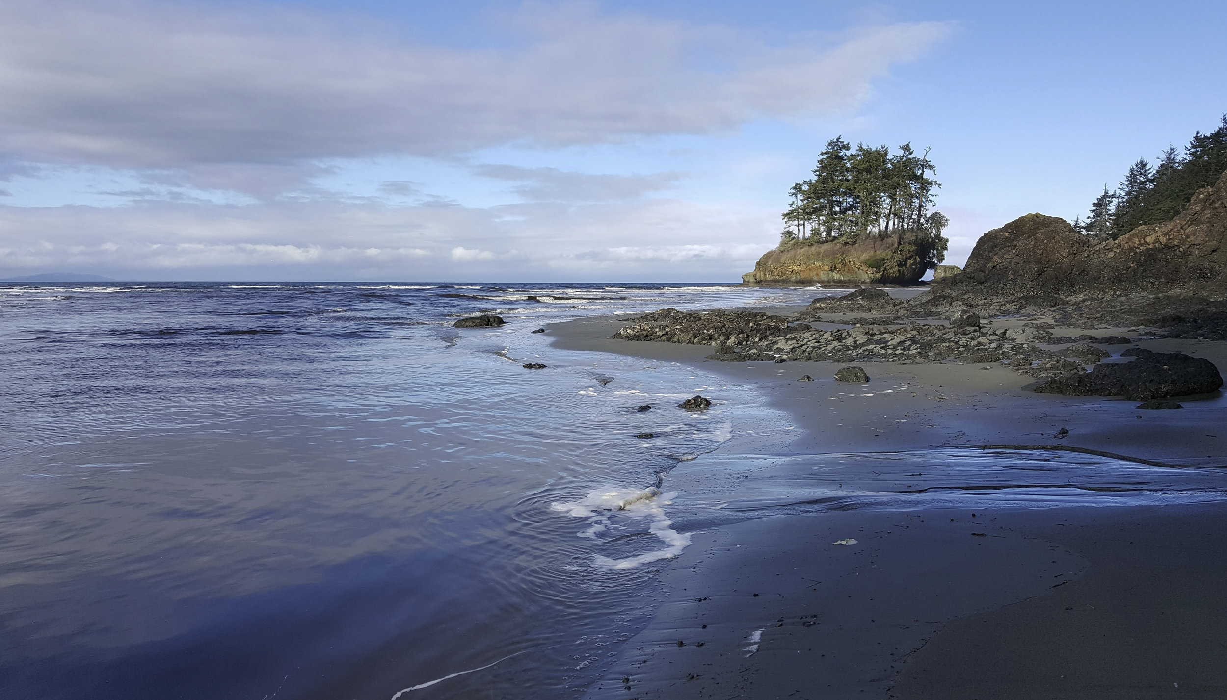 Tongue Point, in the Salt Creek Recreation Area on the north coast of the Olympic Peninsula, is a popular spot for surfers, tide pool explorers, and beach walkers. Photo by Robin Stanton / The Nature Conservancy.