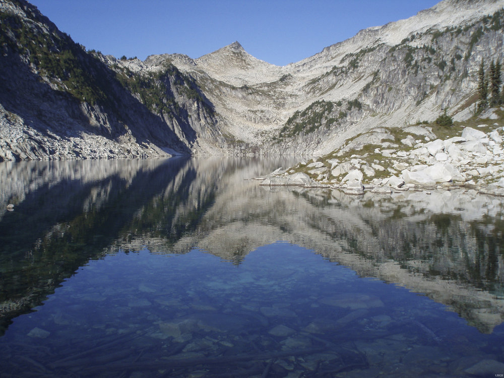 Hidden Lake's stillness is due in part to LWCF's federal grant program, which has helped keep North Cascades National Park whole. Photo by Richard Sheibley, USGS, Public Domain.