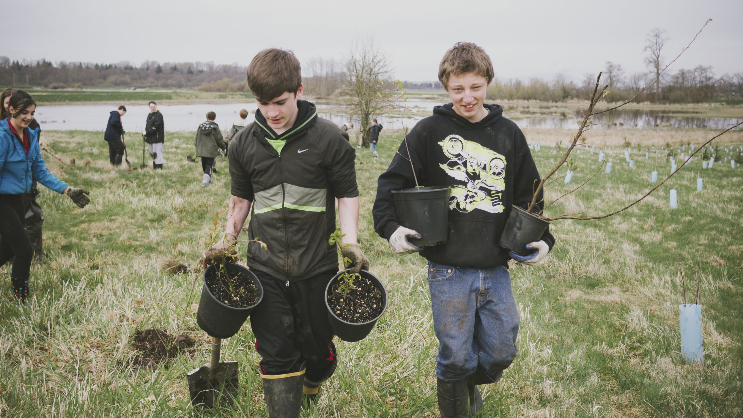 Students from Conway Middle School help restore trees at Fisher Slough.  Photo by Don Macanlalay / The Nature Conservancy.