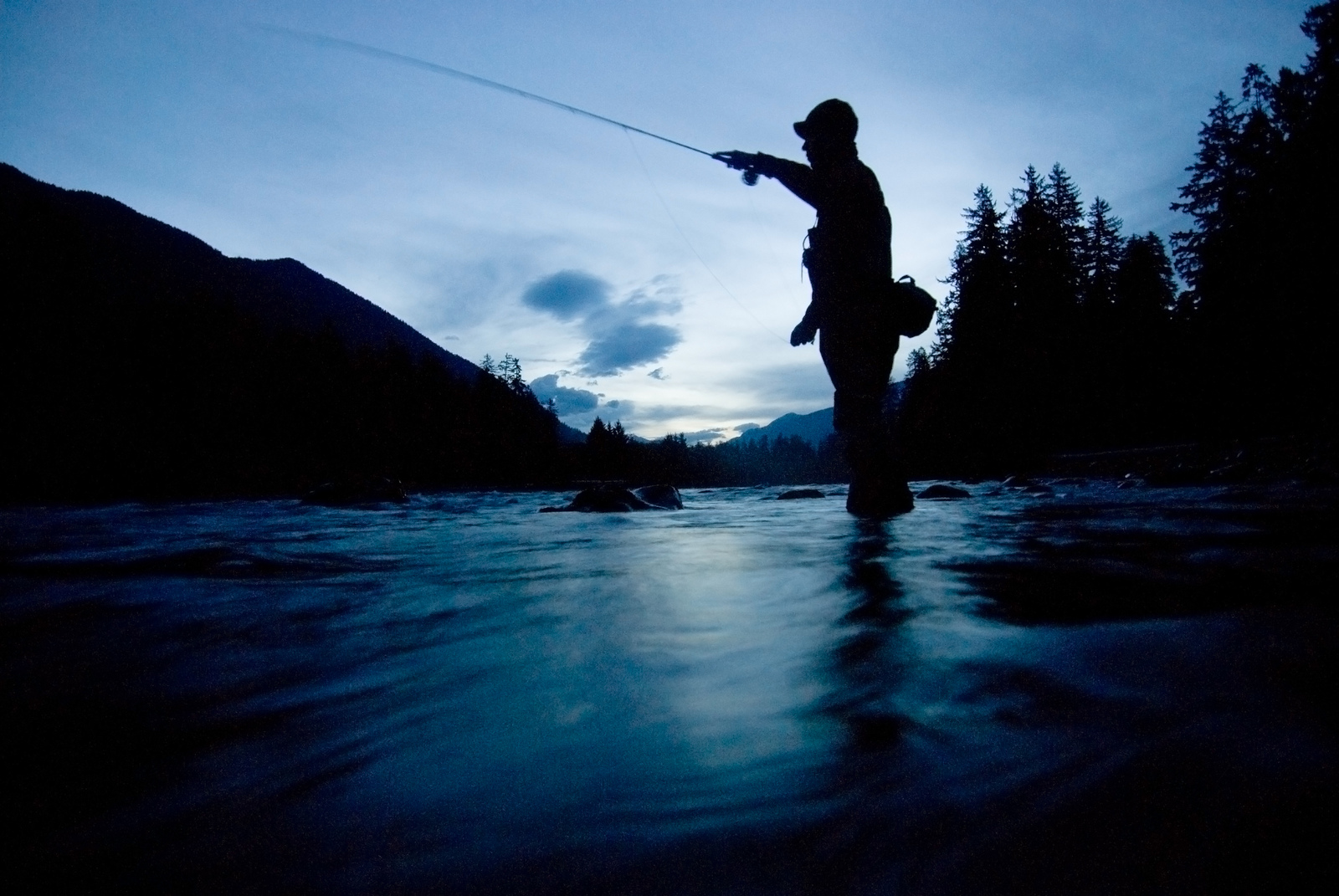 Fishing guide Shannon Carroll flyfishing at dawn for steelhead on the Hoh River in the Olympic Peninsula of Washington. © Bridget Besaw