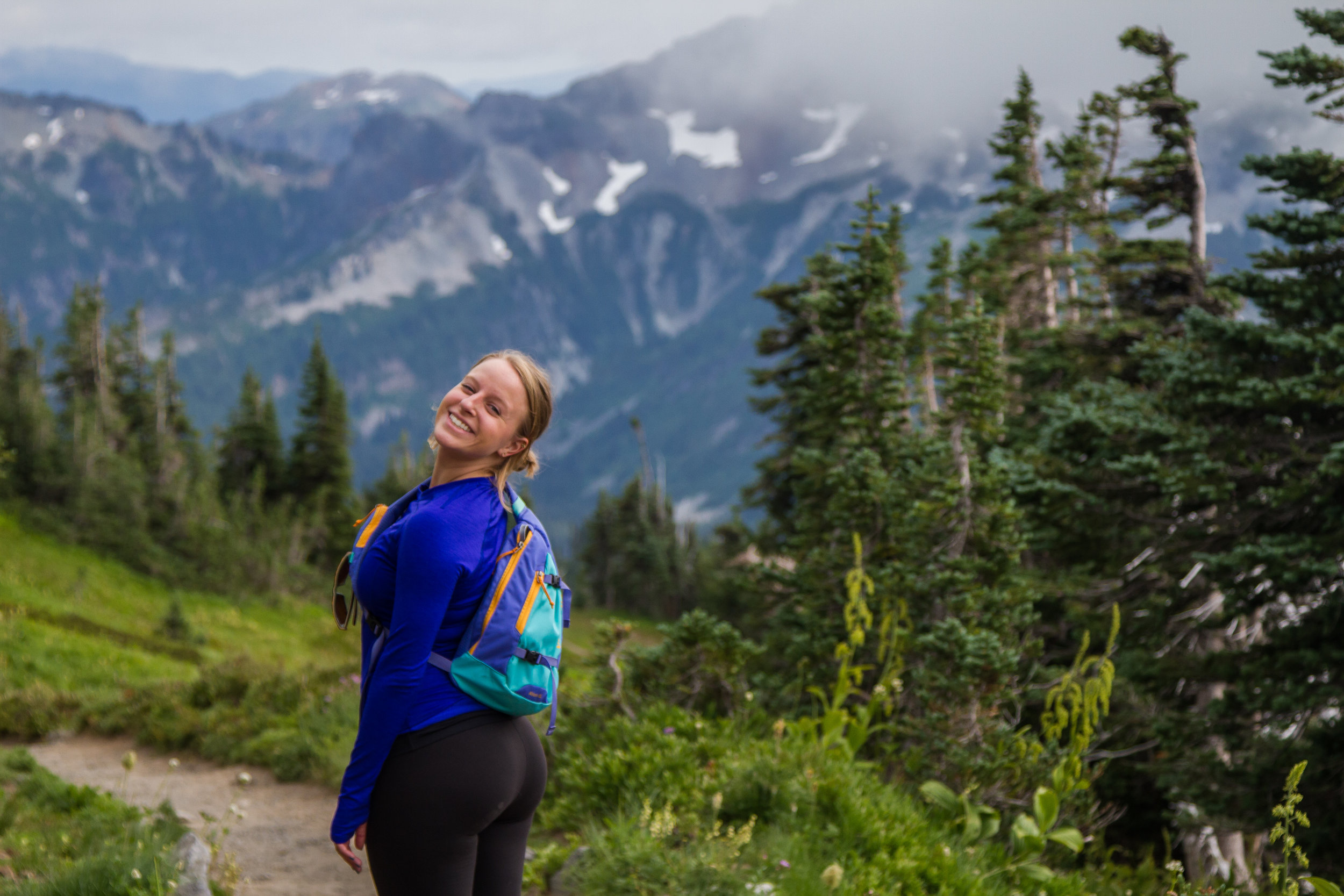 Friend, Amelia Brown, with a look of pure joy that can only come from spending a day in alpine Paradise. © Kelly Compton
