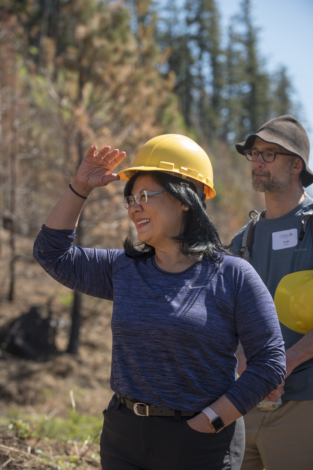 Jenette Ramos during a day of tree planting in a burned landscape on Rosyln Ridge. © Hannah Letinich