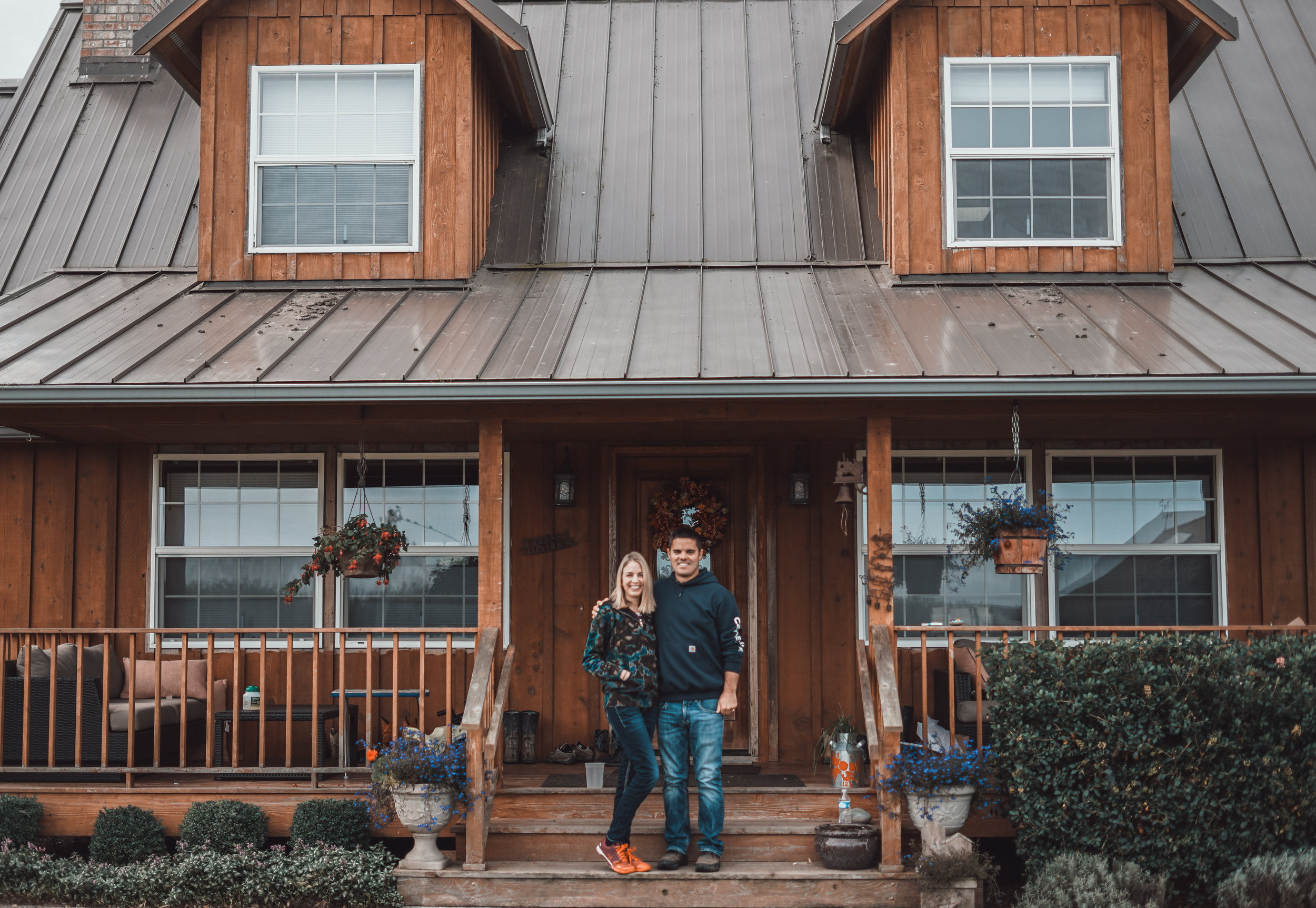Ryan and Sarah McCarthey in front of their farmstead home. Photo by Courtney Baxter / TNC