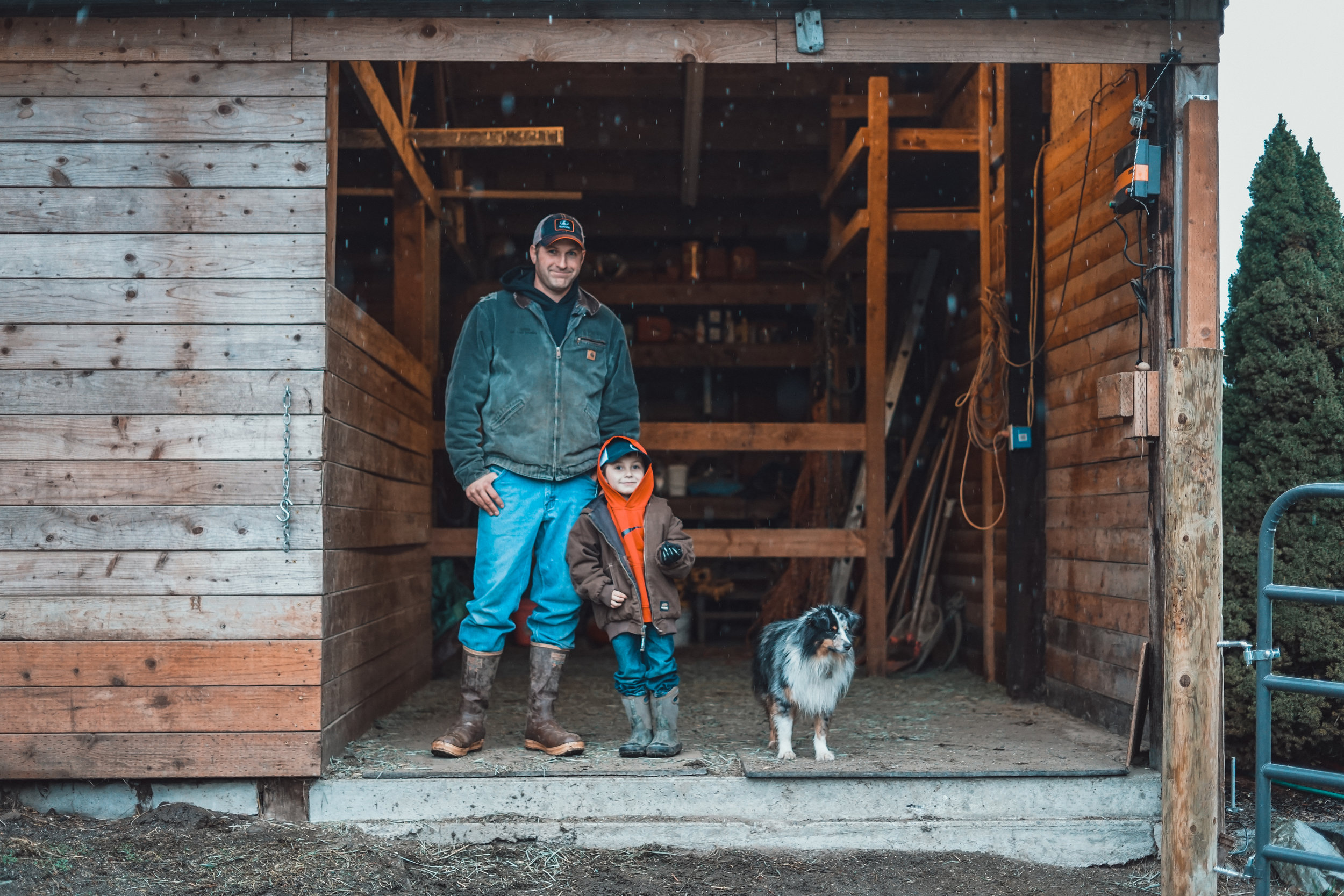 Tory Kowalczyk with his son and dog on their farm in Mount Vernon. Photo by Courtney Baxter / TNC