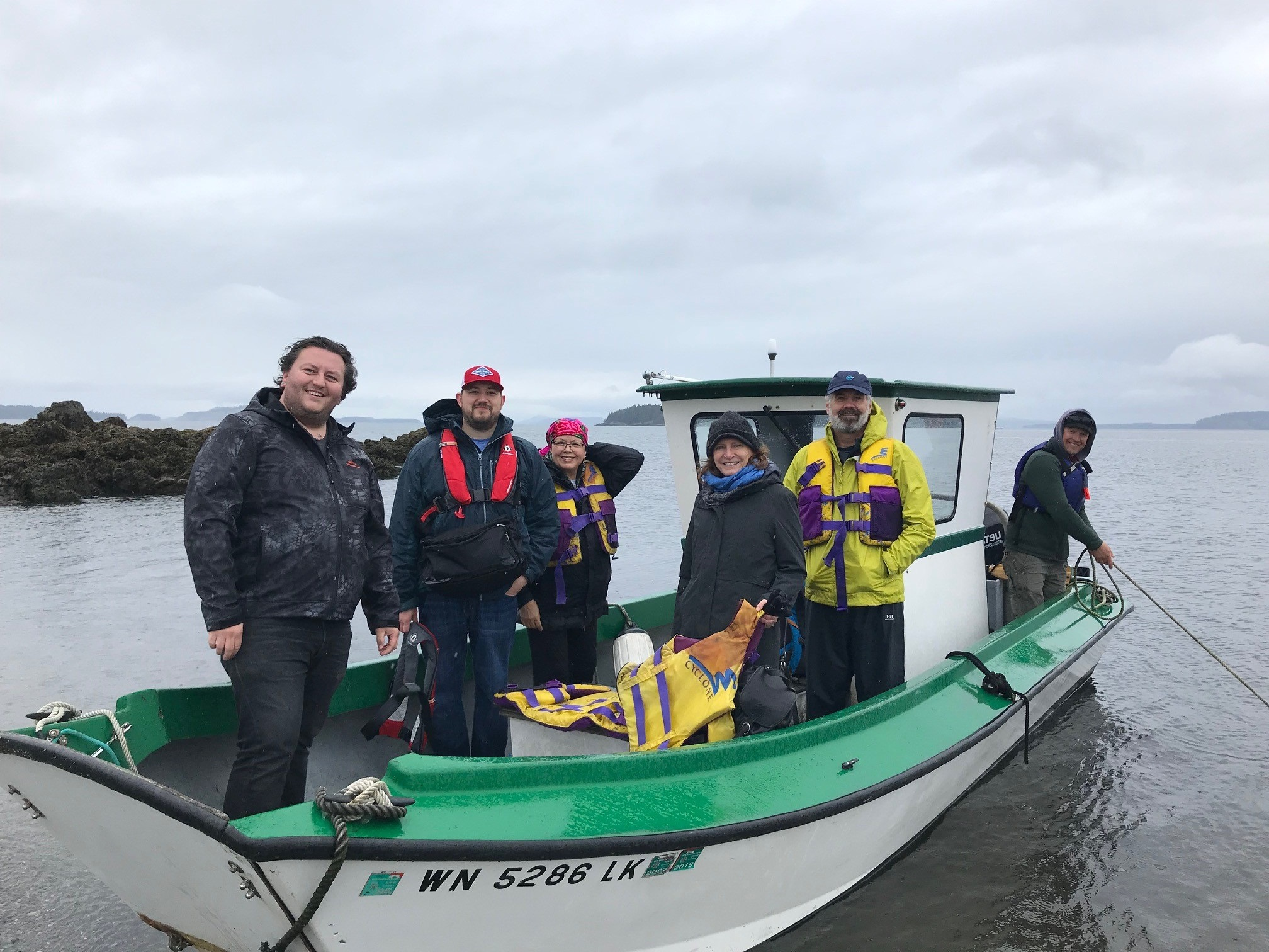 Tulalip tribal members and TNC staff head to the island.