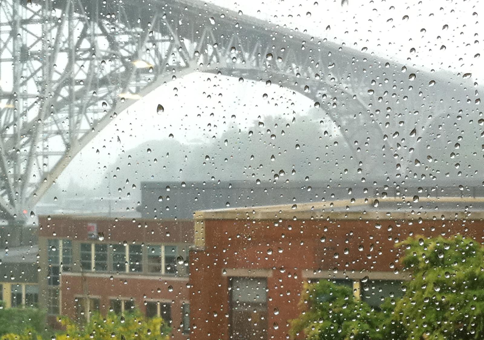 Looking out at Aurora Bridge during rainstorm. Photo © Heather Van Steenburgh.