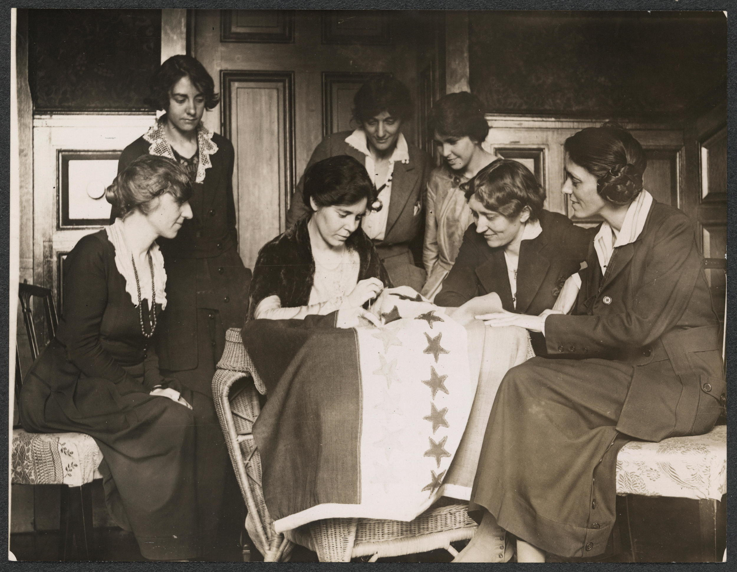 Alice Paul sews a star onto the NWP Ratification Flag, representing another state's ratification of the 19th Amendment, Library of Congress.