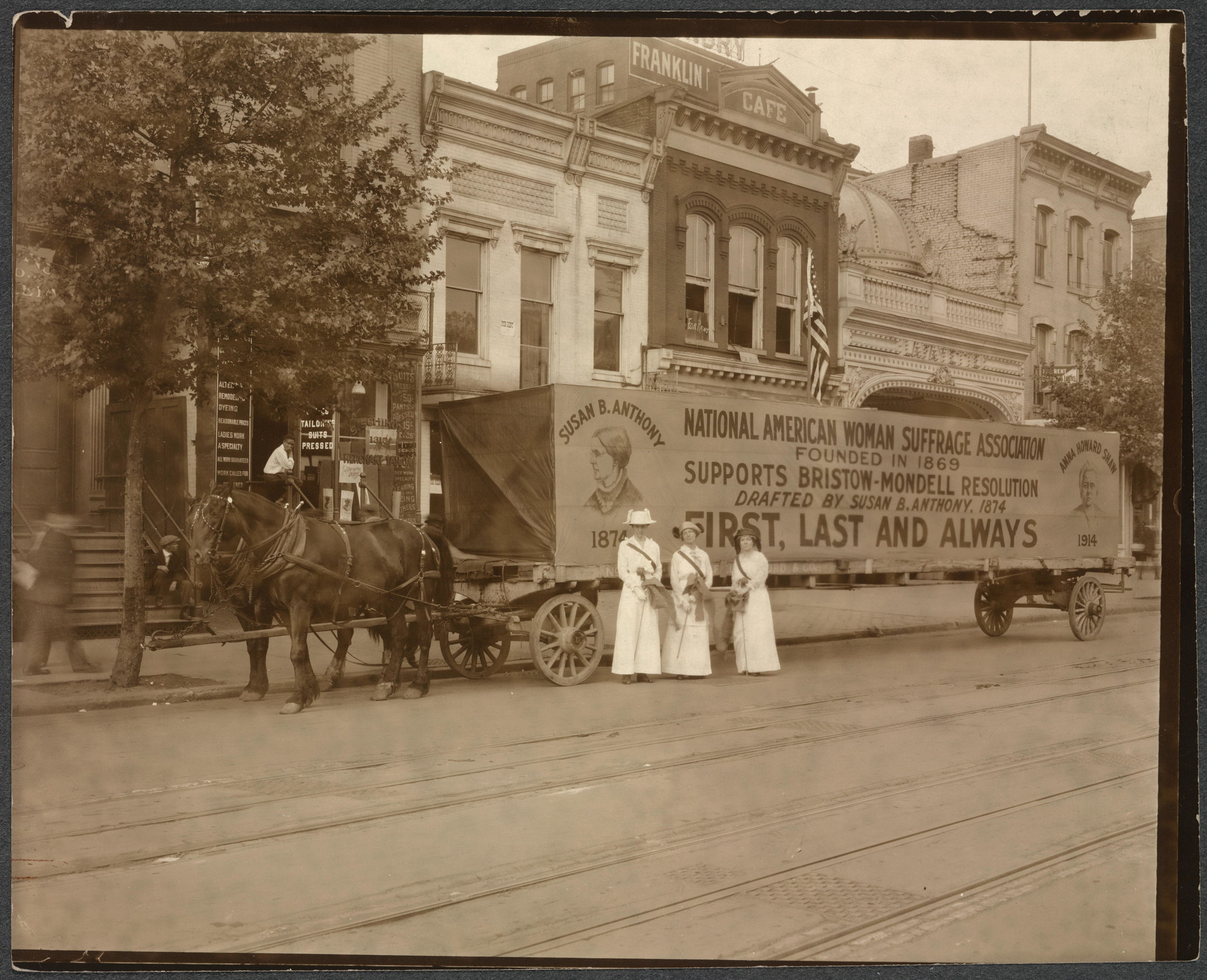 Horse drawn float declares National American Woman Suffrage Association's support for Bristow-Mondell amendment