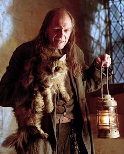 Argus Filch (David Bradley) and  Mrs. Norris (Pebbles) in  the Harry Potter series.