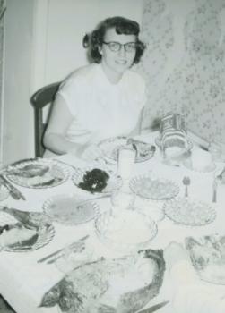 My mother, enjoying her Thanksgiving feast, 1950.