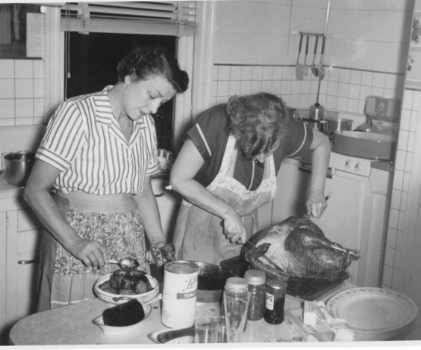 My great-aunt Ada and my grandmother, preparing the feast, 1952.