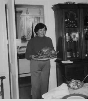 My mother-in-law serving the feast, circa 2000.