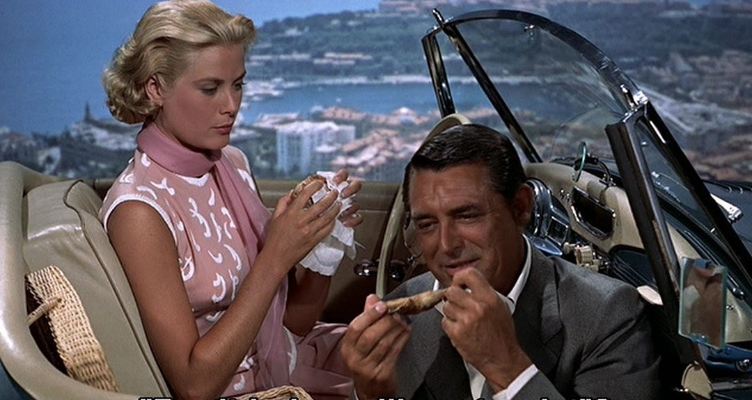"The screen's hottest picnic: Francie Stevens (Kelly) and John Robie, ""The Cat"" (Grant) in her Sunbeam-Talbot Alpine Sports Mk I roadster.  To Catch A Thief  (1955)"