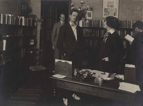 James Joyce with Sylvia Beach (center), John Rodker (left) and Cyprian Beach (right) at Shakespeare and Company, 1921 (Image courtesy of the Poetry Collection of the University Libraries, University at Buffalo, The State University of New York.)