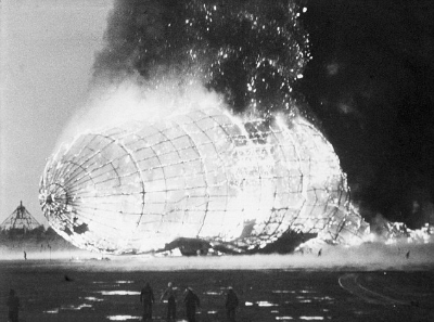 The Hindenburg ignited and was consumed by flames in seconds, killing 36.