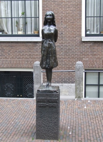 Statue of Anne Frank beside the Anne Frank House.