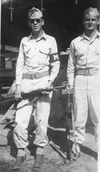 "Uncle Bill on duty with ""his buddy,"" Sgt. Bader, New Guinea, May 1944."