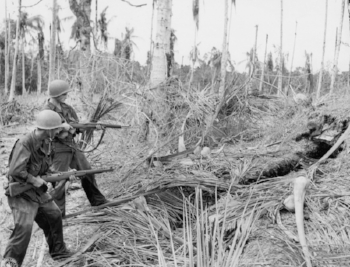 "Soldiers clear a bunker in New Guinea, 1944. Bill writes, ""you get a little sick & scared & mad as H."""