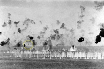 "The anti-aircraft fire whitens the water ahead of an incoming kamikaze. Jack writes, ""His pendulum-like sway makes him a tough target. Closer and closer he comes…they always look closer. Just when it seems he will prevail, one wing shears off, then the other, he bursts into flames and hits the water in a tumbling splash. There is wild cheering."""