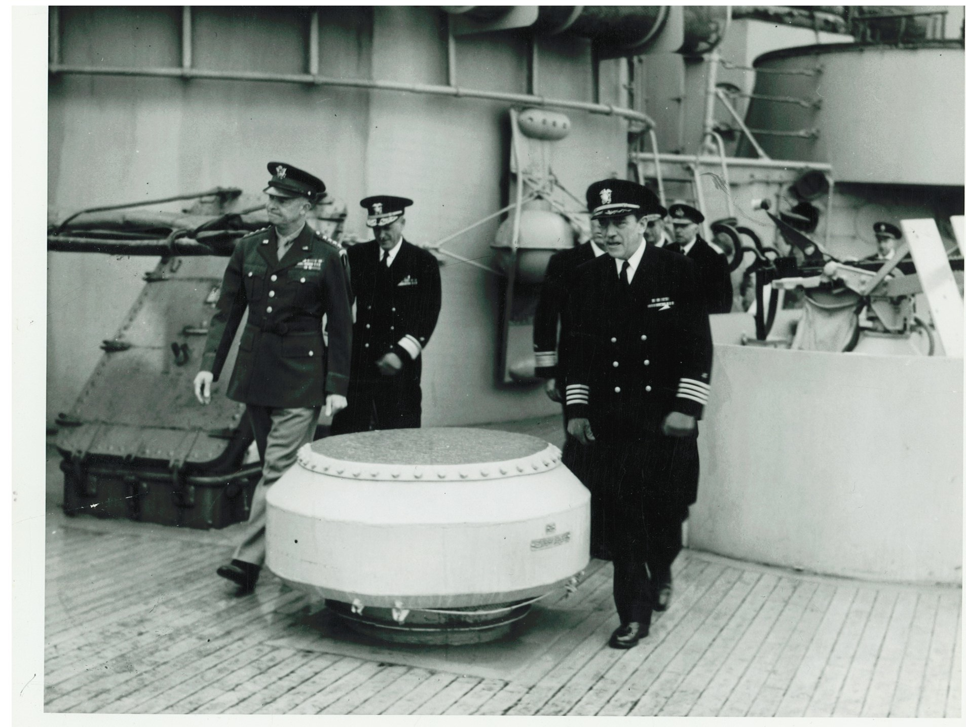 [Foreground, left to right] General Dwight D. Eisenhower, Rear Admiral Carleton F. Bryant, Captain Charles Adam Baker, May 19, 1944 on board the  USS Texas  in Belfast Lough, Ireland.