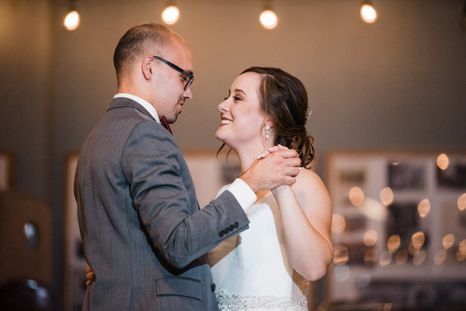 Newlywed's first dance at Americas Packard Museum wedding reception