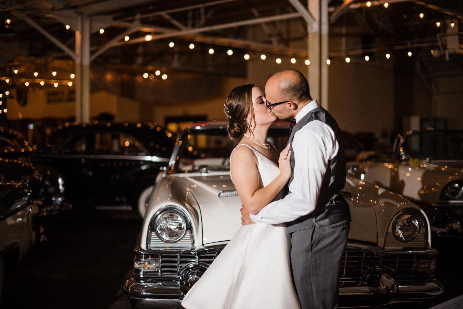 Final kiss!Americas Packard Museum wedding reception