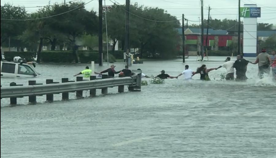 Man rescued from Houston floodwaters by human chain. Picture: Storyful