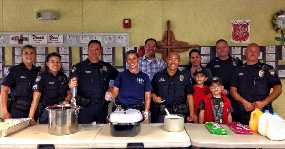 Officer Peacey and other BPD volunteers serving food at the Salvation Army