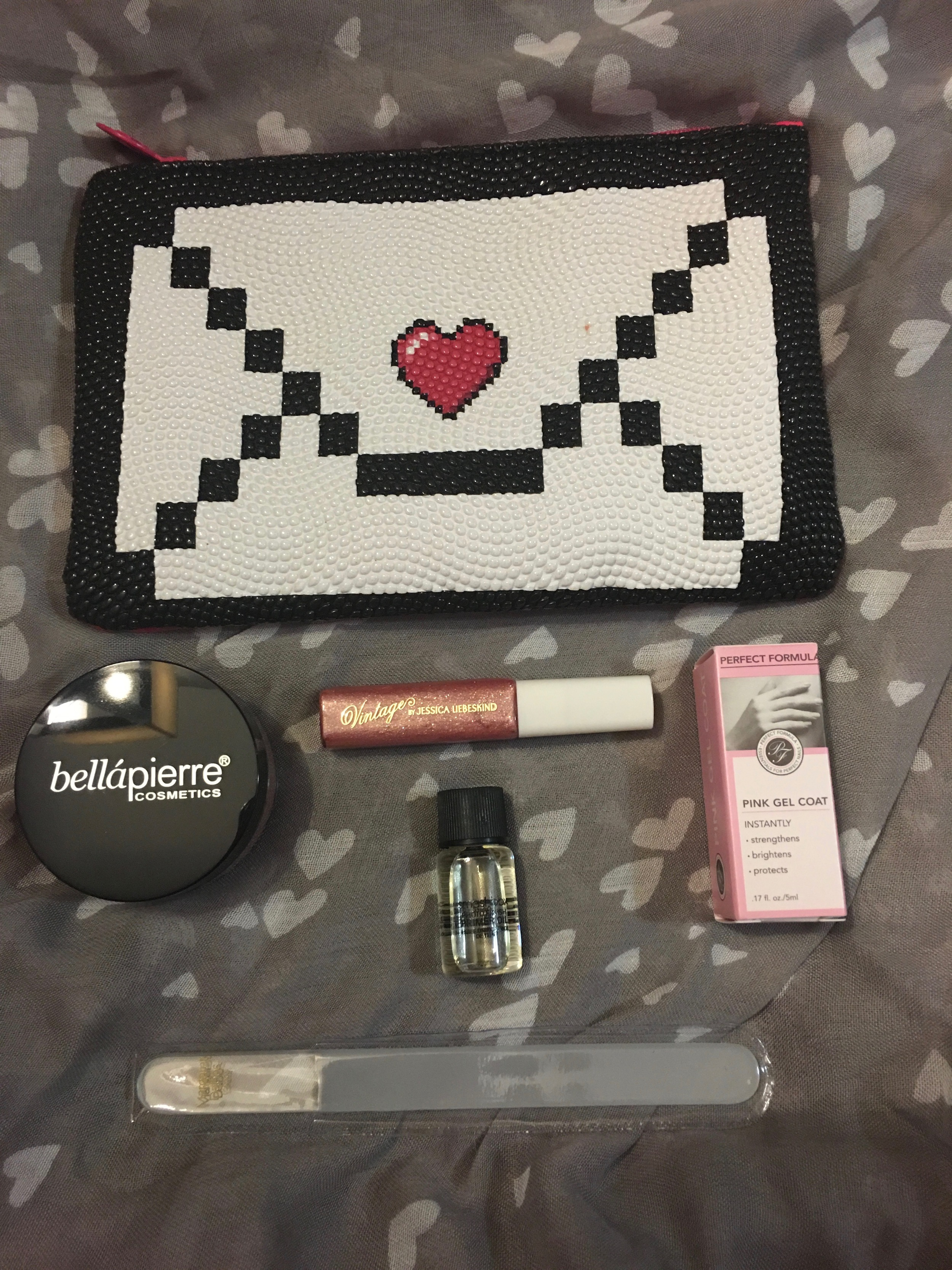 All of the ipsy goodies.  I promise you don't need to see the color of the blush. It will only disappoint you.