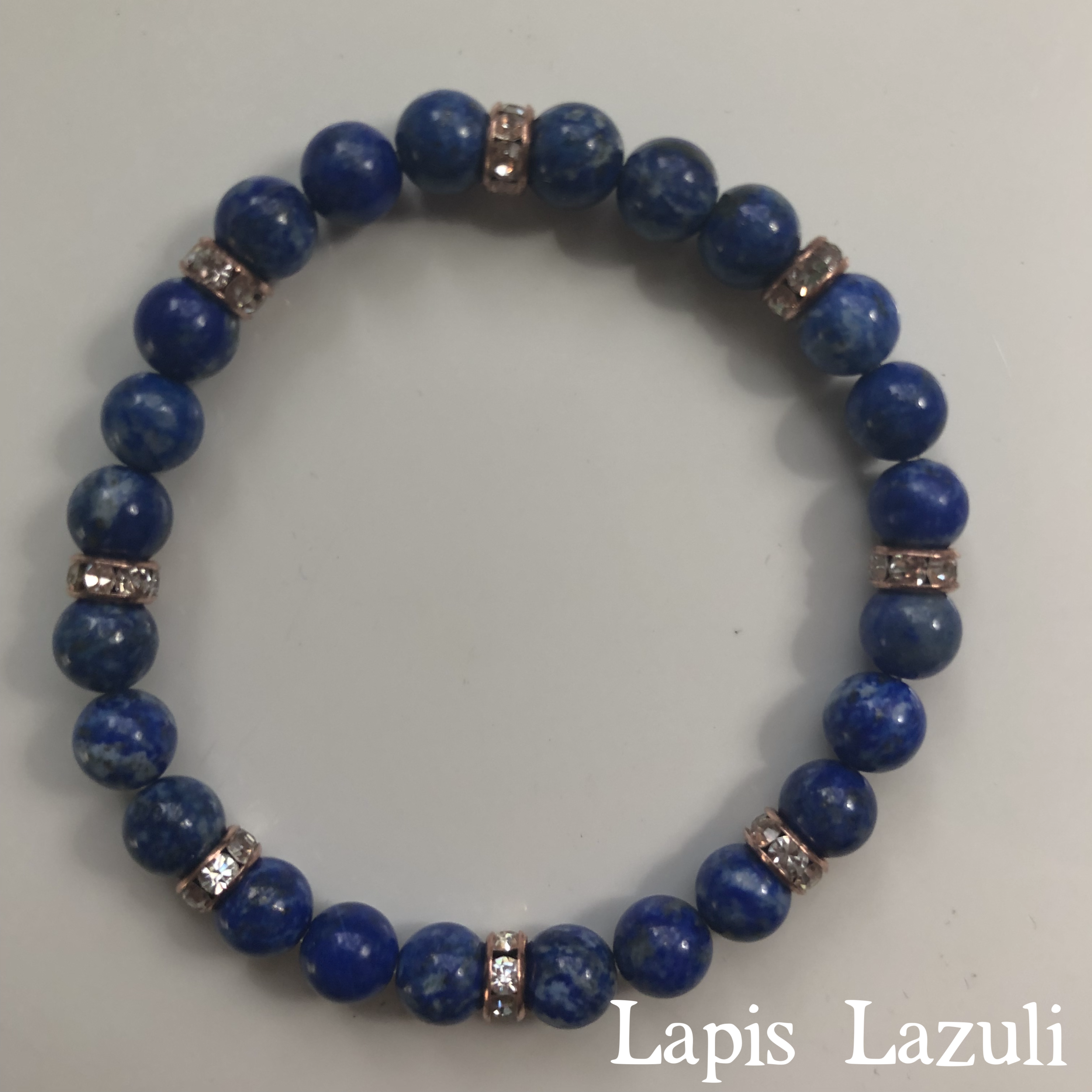 """Lapis Lazuli Bracelet($30.00):  This is probably my favorite piece of the day. It's official name is the """"speak your truth reiki blessed energy bracelet,"""" and it opens up your throat chakra, stimulates your intuition, and is a great harmonizer. Lapis is said to create a bridge between the physical and the spiritual realm, and help you further connect to your soul purpose. Energy Muse (my crystal bible, clearly) has a great article about lapis  here , and you can purchase a variety of beautiful pieces  from this seller here ."""